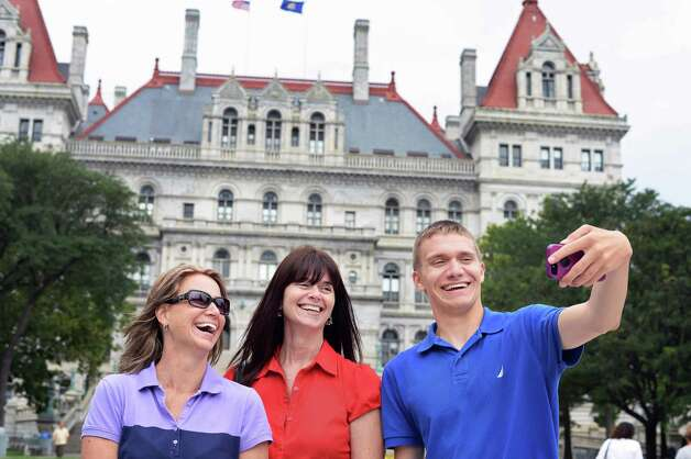 Jacob Vassalotti, right, of Newark, Delaware takes a selfie with his aunt Christy Smart of Chesapeake, Virginia, and mother Tina Vassalotti, left, in front of the state Capitol Wednesday July, 15, 2015 in Albany, NY. The trio is visiting the Capital District as Jacob checks out RPI and Union College.  (John Carl D'Annibale / Times Union) Photo: John Carl D'Annibale