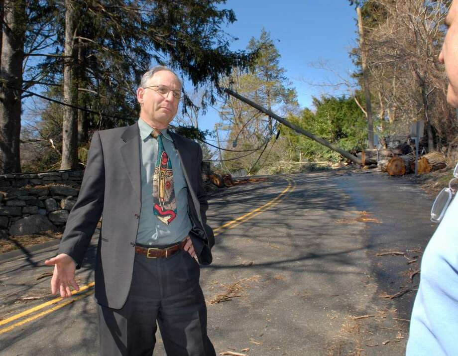 Greenwich Superintendent of schools,  Dr. Sidney A. Freund, left, surveys the damage on Clapboard Ridge Road in Greenwich along with a Ted Milone, right, a representative from CL&P during a bus and walking tour of storm-ravaged areas in Greenwich, Wednesday, March 17th, 2010. Photo: Bob Luckey / Greenwich Time
