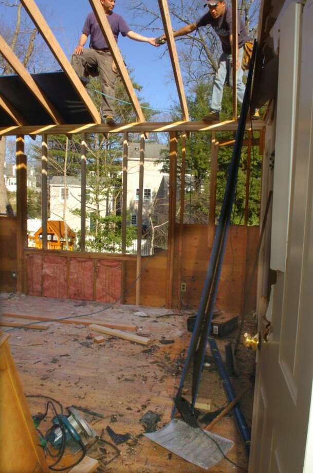 Annette and Bob Intrieri's bedroom in their home on Valley Wood Road  was destroyed when a tree landed in the room during the storm.  The tree has since been cut up, and construction has been started. Photo: Helen Neafsey / Greenwich Time