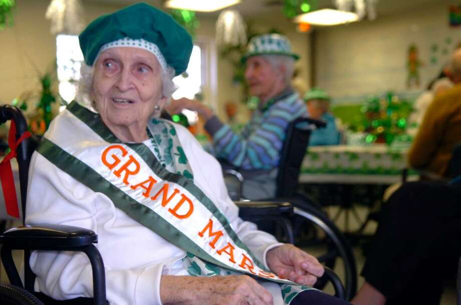 Helen Oslen, almost 90, one of 2 grand marshalls at the Nathaniel Witherell's St.Patrick's Day party,  in Greenwich, on March 17, 2010. Photo: Helen Neafsey / Greenwich Time