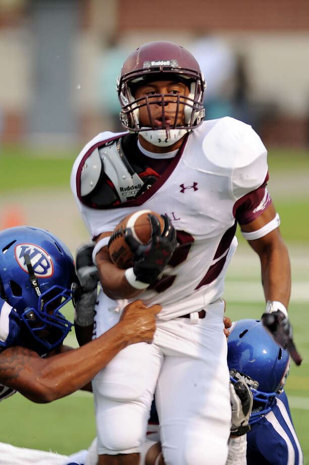 Central High's Devwah Whaley will make an unofficial visit to the University of Georgia this weekend. The Bulldogs are one of five schools Whaley is considering signing with. The Central Jaguars Devwah Whaley, 12, pushes for yardage with a couple of West Brook Bruins trying to drag him down at the Carroll Thomas Stadium Friday night. Photo by Drew Loker. Photo: File Photo / www.DrewLoker.com