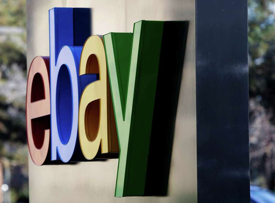 This Jan. 14, 2015 photo shows signage at the entrance to eBay's headquarters in San Jose, Calif. EBay sold its Enterprise business for $925 million and topped Wall Street expectations for its second-quarter earnings Thursday, July 16, 2015, as the online retailer prepares to spin off PayPal. (AP Photo/Marcio Jose Sanchez) ORG XMIT: NYBZ125 Photo: Marcio Jose Sanchez / AP