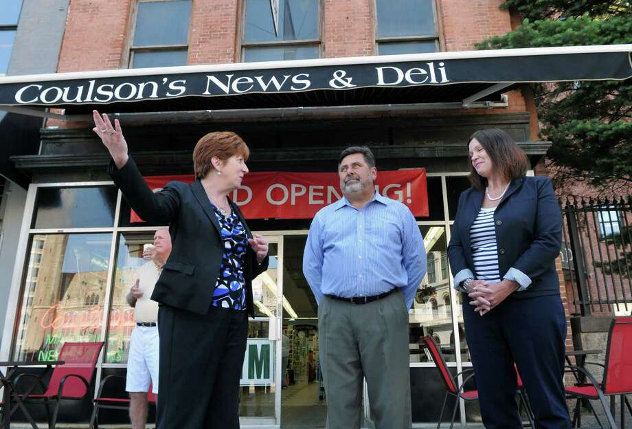 Albany Mayor Kathy Sheehan, left, speaks alongside Coulson's News owner Richard Metzger, center and Downtown Albany BID executive director Georgette Steffens during the opening of a new deli at Coulson's News & Deli Thursday, July 16, 2015, in Albany, N.Y. (Phoebe Sheehan/Special to The Times Union) Photo: PS / 00032647A