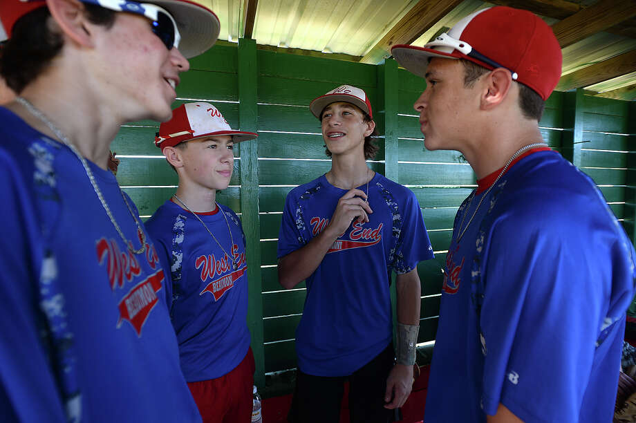From left, Tripp Daleo, Tyler Sterling, Mitchell Breaux, and Justin Smith joke in the dugout on a water break as Beaumont's West End Junior League baseball team practices Thursday in preparation for their run at the state championship in Tyler this weekend. Photo taken Thursday, July 16, 2015 Kim Brent/The Enterprise Photo: Kim Brent / Beaumont Enterprise