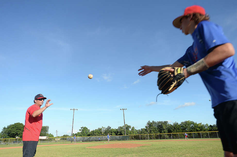 Mitchell Breaux tosses another ball to coach Brian Cansler as Beaumont's West End Junior League baseball team practices Thursday in preparation for their run at the state championship in Tyler this weekend.