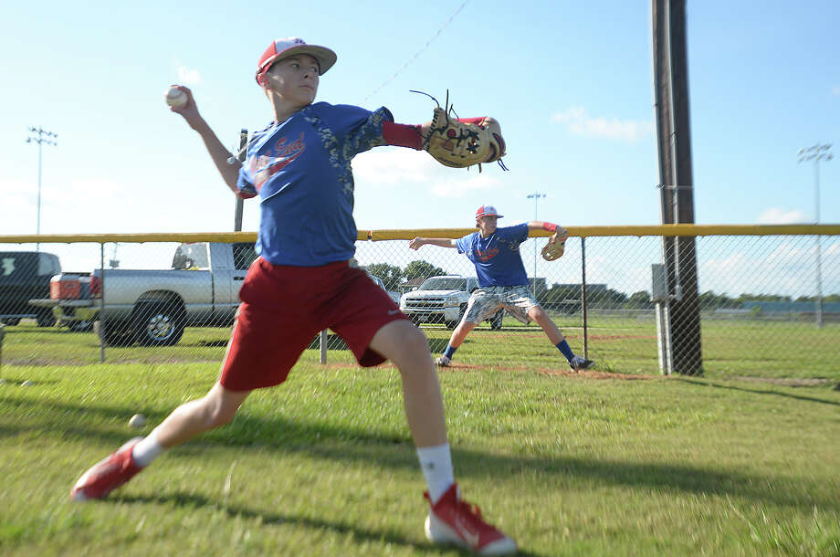 From left, Tyler Sterling and Harrison Salter work on their pitching as Beaumont's West End Junior League baseball team practices Thursday in preparation for their run at the state championship in Tyler this weekend. Photo taken Thursday, July 16, 2015 Kim Brent/The Enterprise Photo: Kim Brent / Beaumont Enterprise