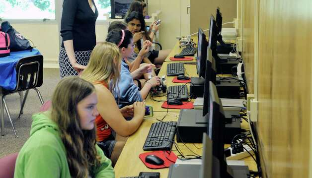 Girls work on computers at the 3D Printing and Technology Camp at the Academy of the Holy Names on Thursday, July 16, 2015, in Albany, N.Y. Students in the camp learned to design 3D objects and worked with a 3D printer on loan from RPI. They worked with simple circuits and LEDs and they built and programed Lego robot kits, on loan from the SUNY Polytechnic Institute. Donna Mooney, coordinator of science research and a physics teacher at the school and Elizabeth Vanderhoef, a 2007 graduate of Academy of the Holy Names and a high school physics teacher in Holland Patent, N.Y. said that they plan to hold the technology camp for girls next summer.  (Paul Buckowski / Times Union) Photo: PAUL BUCKOWSKI / 00032641A