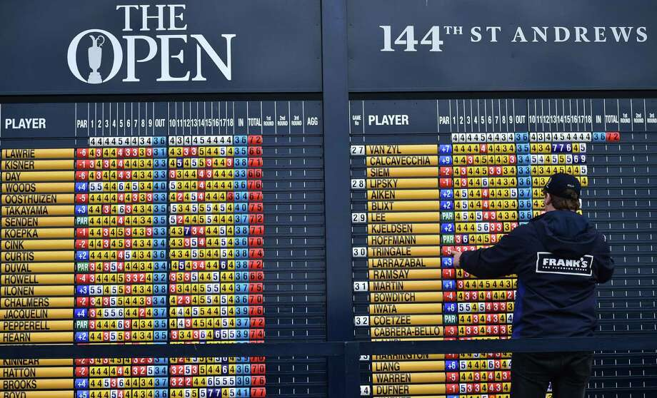 An official changes the scores on the scoreboard on the opening day of the 2015 British Open Golf Championship on The Old Course at St Andrews in Scotland, on July 16, 2015. AFP PHOTO / BEN STANSALLBEN STANSALL/AFP/Getty Images Photo: BEN STANSALL, Staff / AFP / Getty Images / AFP