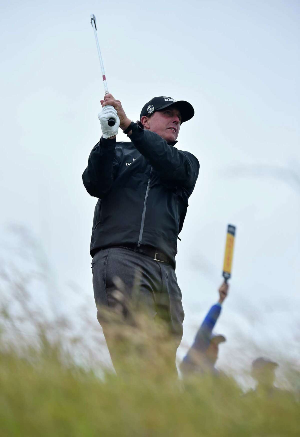 US golfer Phil Mickelson watches his shot from the 16th tee during his first round 70, on the opening day of the 2015 British Open Golf Championship on The Old Course at St Andrews in Scotland, on July 16, 2015. AFP PHOTO / BEN STANSALLBEN STANSALL/AFP/Getty Images