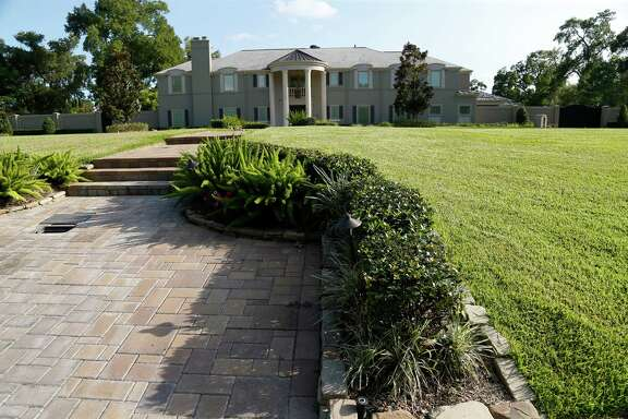 The $1.7 million home of Marian Annette Cluff and Alsie Cluff Jr. at 3430 S. Parkwood Drive photographed on Thursday, July 16, 2015, in Houston.  The founding superintendent of Houston's Varnett charter school and her husband have been indicted on charges of embezzling more than $2.6 million intended to benefit impoverished students, the U.S. Attorney's Office announced Thursday.( Karen Warren / Houston Chronicle )