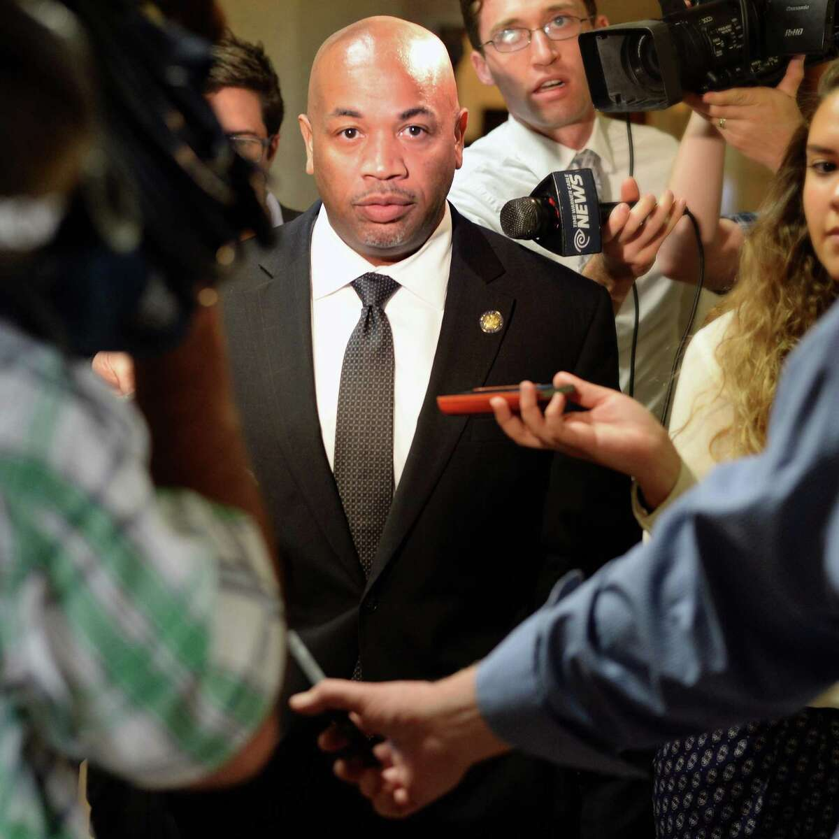 Assembly speaker Carl Heastie is beset by reporters following his meeting with Gov. Cuomo Wednesday June 17, 2015 at the Capitol in Albany, NY. (John Carl D'Annibale / Times Union)