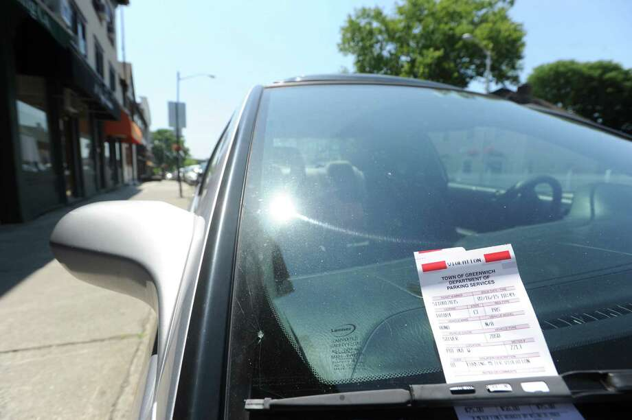 A vehicle with a parking ticket attached to its windshield on West Putnam Avenue in Greenwich on Thursday. Photo: Bob Luckey Jr. / Hearst Connecticut Media / Greenwich Time