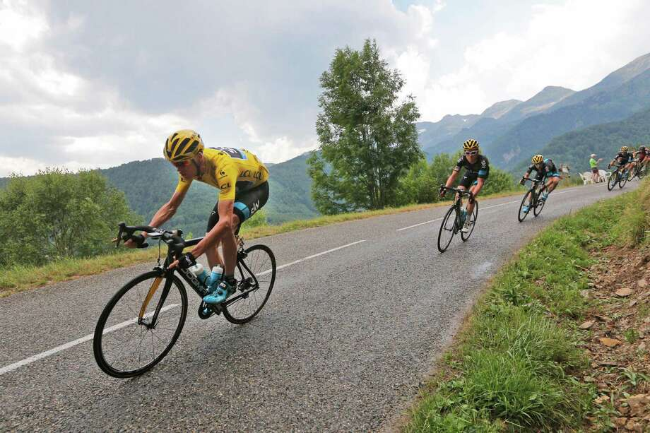 Britain's Chris Froome, wearing the overall leader's yellow jersey, speeds downhill during the twelfth stage of the Tour de France cycling race over 195 kilometers (121.2 miles) with start in Lannemezan and finish in Plateau de Beille, France, Thursday, July 16, 2015. (AP Photo/Christophe Ena) ORG XMIT: PDJ105 Photo: Christophe Ena / AP