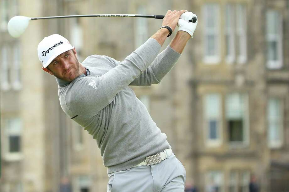 ST ANDREWS, SCOTLAND - JULY 16:  Dustin Johnson of the United States tees off on the 2nd hole during the first round of the 144th Open Championship at The Old Course on July 16, 2015 in St Andrews, Scotland.  (Photo by Andrew Redington/Getty Images) ORG XMIT: 541146101 Photo: Andrew Redington / 2015 Getty Images