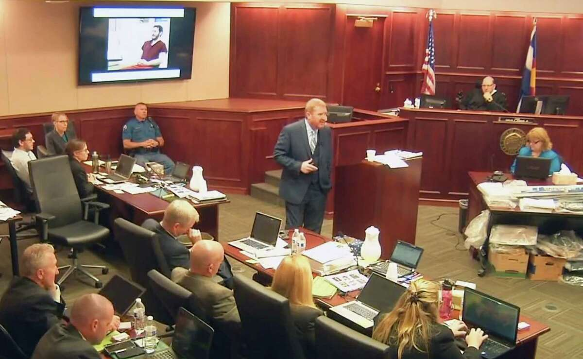 In this image taken from video, accused Colorado theater shooter James Holmes, on the upper far left, listens to defense attorney Daniel King give closing arguments during his trial, in Centennial, Colo., Tuesday, July 14, 2015. (Colorado Judicial Department via AP, Pool) ORG XMIT: COLO104