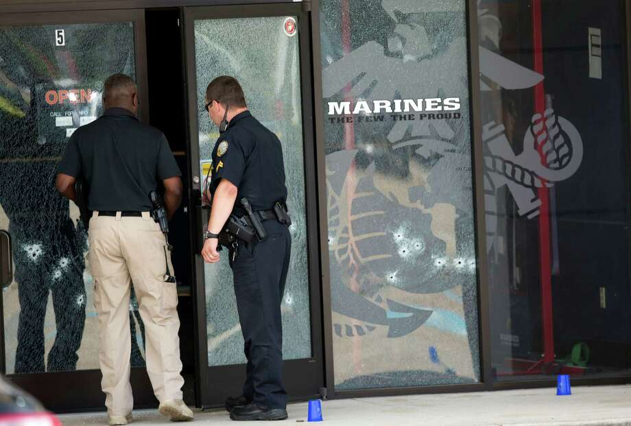Police enter the military recruiting station through a bullet- riddled door after a gunman opened fire on the building in Chattanooga, Tenn. Photo: John Bazemore / Associated Press / AP