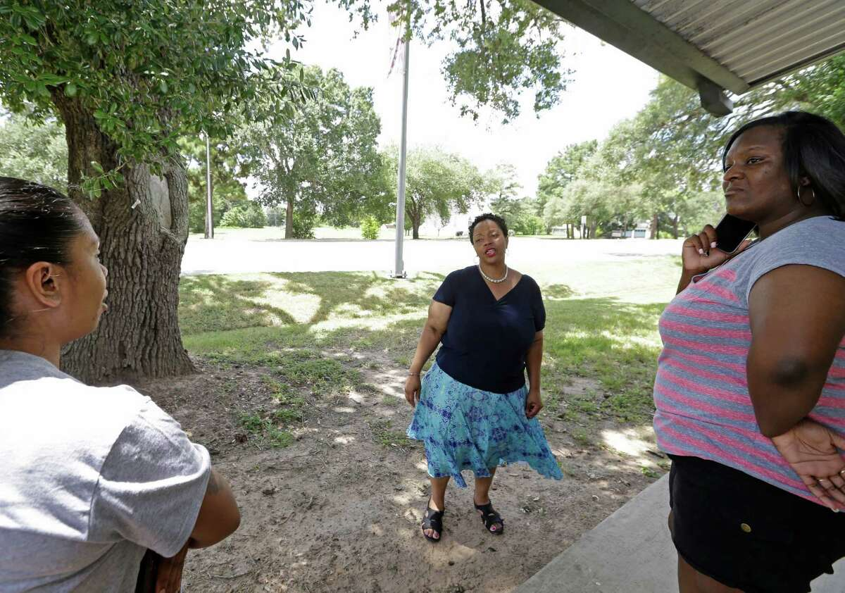 Renee McKnight, center, co-owner of C & R Uptown Barber & Beauty Salon, 700 University Dr., Thursday, July 16, 2015 in Prairie View, talks about seeing the struggle and arrest by police of Sandra Bland that occurred directly across the street from her salon. After being arrested on Friday, Bland was found dead at the Waller County jail on Monday.