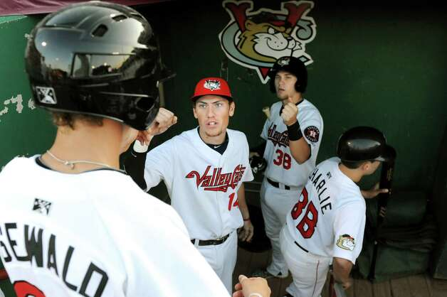 ValleyCats Bobby Wernes, center, celebrates a run with Johnny Sewald, right, during their baseball game on Thursday, July 16, 2015, at Joe Bruno Stadium in Troy, N.Y. (Cindy Schultz / Times Union) Photo: Cindy Schultz / 00032628A