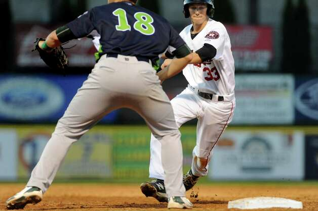 ValleyCats Johnny Sewald, right, sprints back to first as Lake Monsters Chris Iriart defends during their baseball game on Thursday, July 16, 2015, at Joe Bruno Stadium in Troy, N.Y. (Cindy Schultz / Times Union) Photo: Cindy Schultz / 00032628A