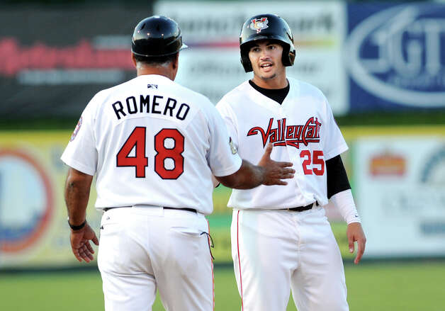 ValleyCats Bryan Muniz, right, arrives safely at third and celebrates with manager Ed Romero during their baseball game against the Lake Monsters on Thursday, July 16, 2015, at Joe Bruno Stadium in Troy, N.Y. (Cindy Schultz / Times Union) Photo: Cindy Schultz / 00032628A