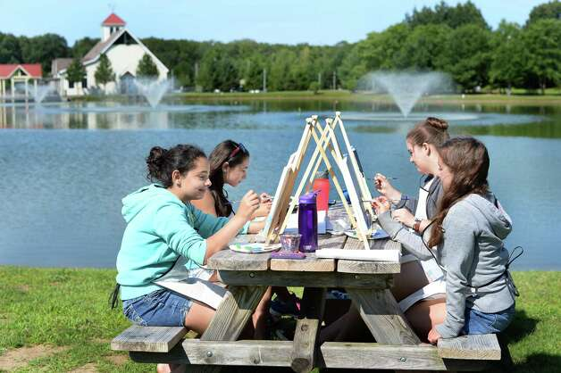 Young artists from the Performance School of the Arts in Clifton Park, from left, Lexi Karam, 12, Brie Karam, 10, Katie Mastromarchi, 13, and Elaine Murdock, 11, paint a landscape en plein air Thursday July 16, 2015 at the Crossings in Colonie, NY.  (John Carl D'Annibale / Times Union) Photo: John Carl D'Annibale / 00032648A