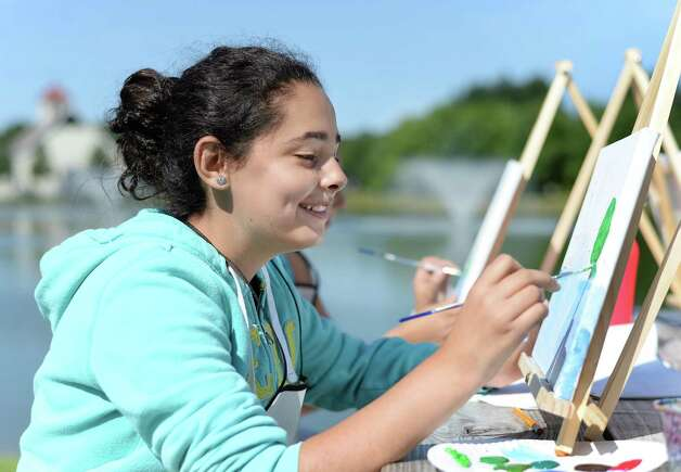 Lexi Karam, 12,  paints a landscape en plein air during a  Performance School of the Arts outdoor art camp Thursday July 16, 2015 at the Crossings in Colonie, NY.  (John Carl D'Annibale / Times Union) Photo: John Carl D'Annibale / 00032648A