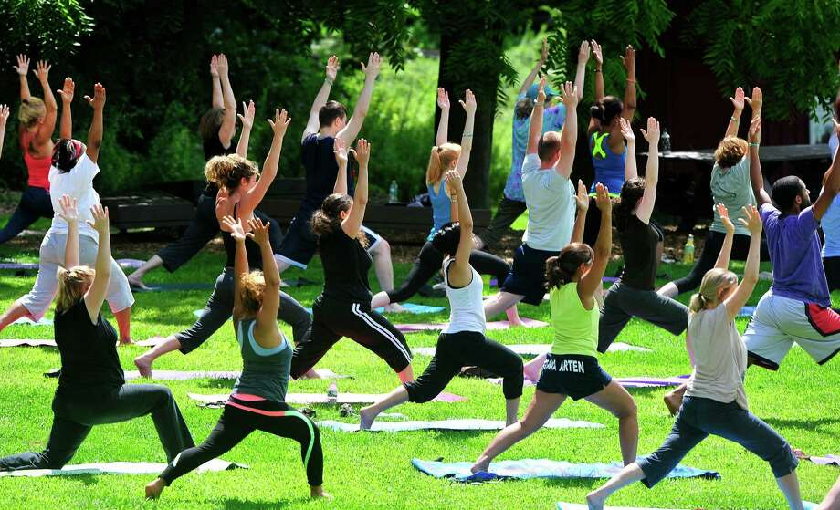Free yoga will be offered this Sunday in Danbury. Photo: Michael Duffy / Michael Duffy / The News-Times