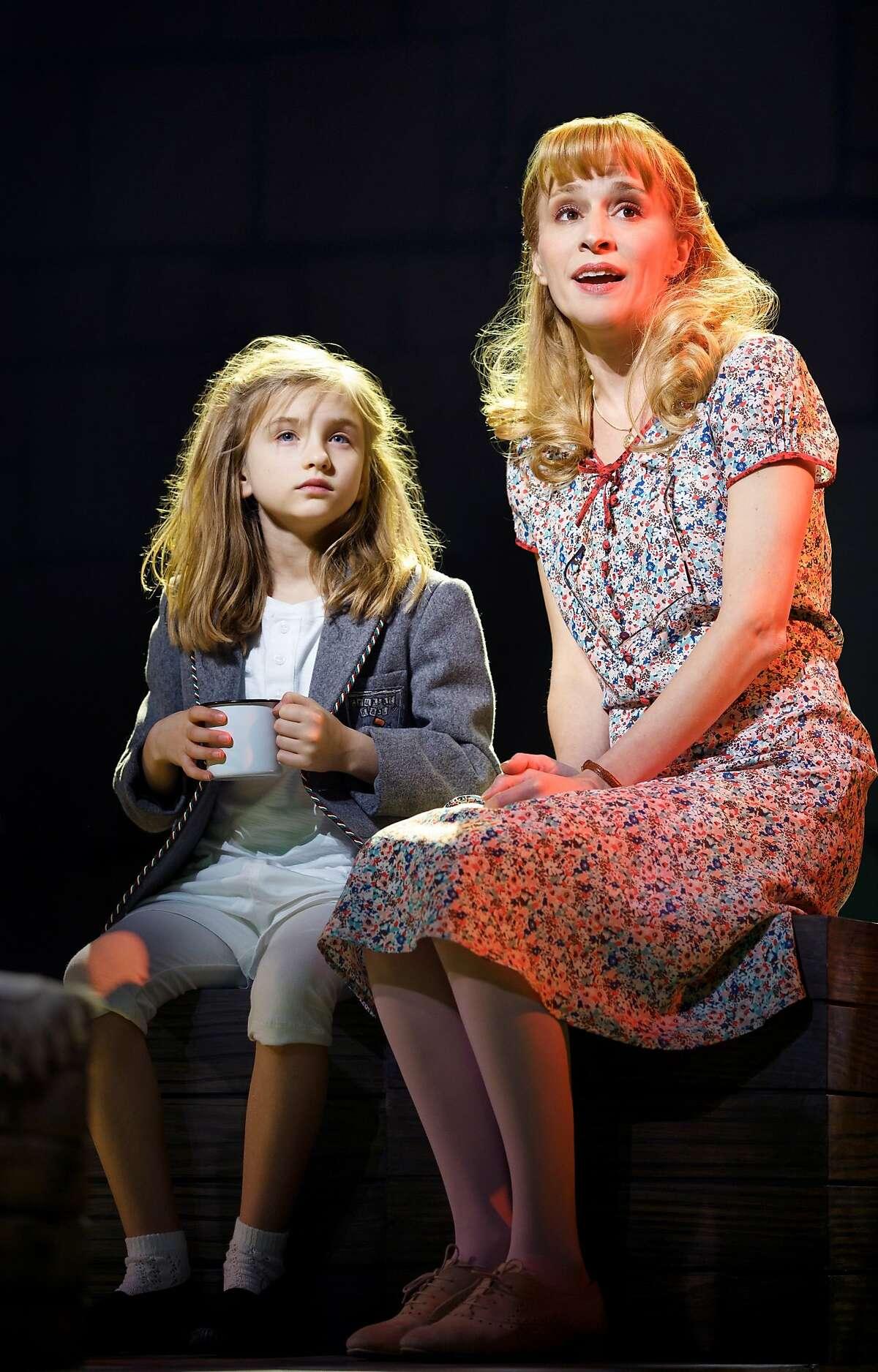Matilda (Mabel Tyler) finds support with her teacher Miss Honey (Jennifer Blood) in