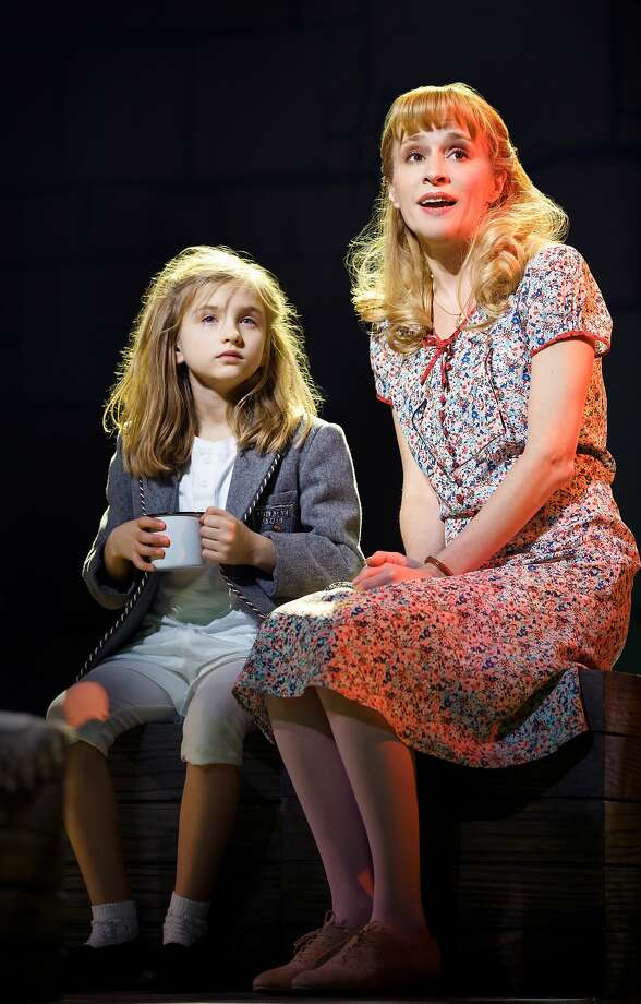 "Matilda (Mabel Tyler) finds support with her teacher Miss Honey (Jennifer Blood) in ""Matilda the Musical."" Photo: Joan Marcus"