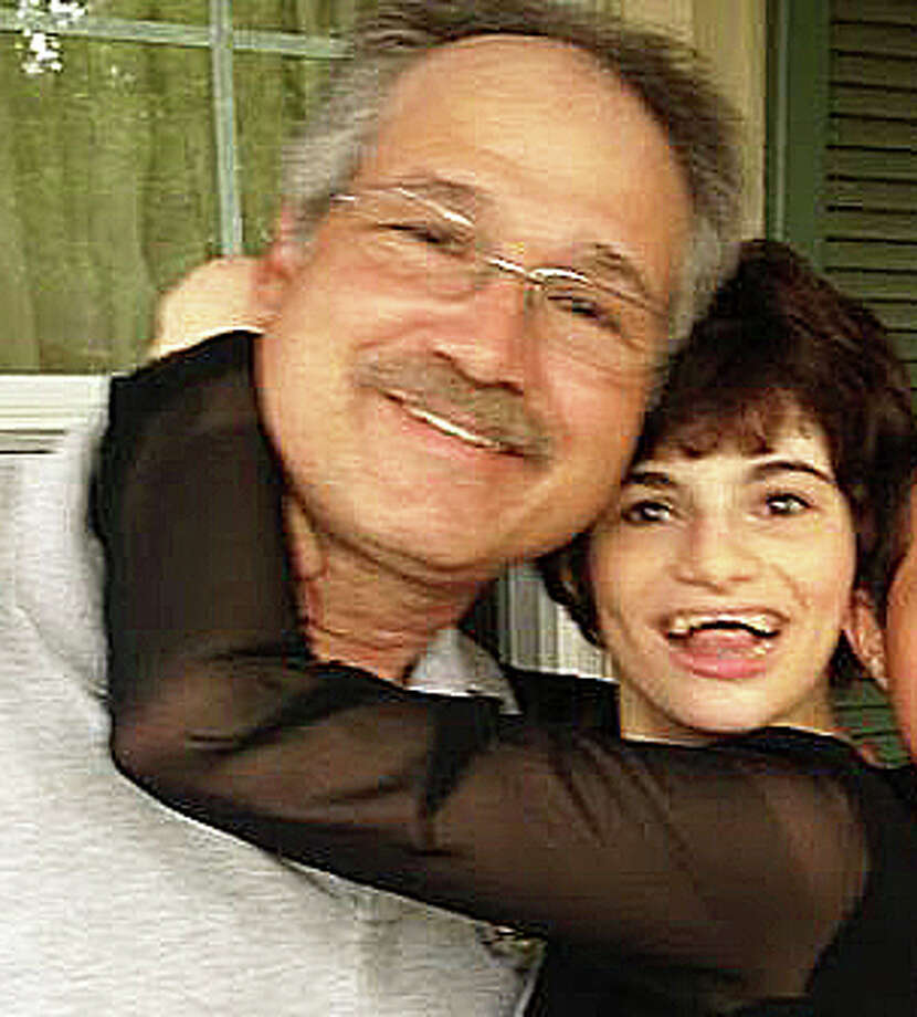Paul O'Neill with his late daughter Katherine, who died in a March 2014 fire in a Crane Street house that she shared with her mother. O'Neill is suing his former wife's estate claiming negligence in his daughter's death. Photo: Contributed Photo / Contributed Photo / Fairfield Citizen
