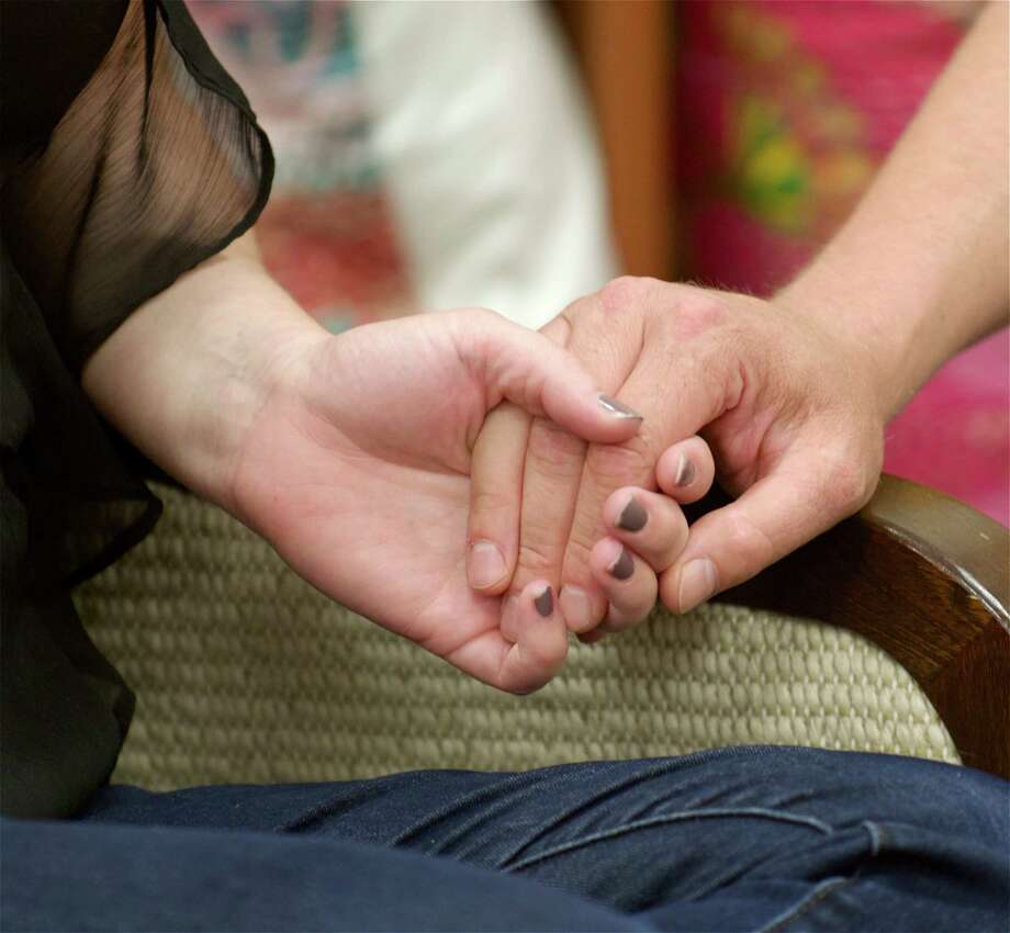 A cancer patient holds hands with her caregiver at Ann's Place, which offers support to cancer patients and their families. An open house at Ann's Place, 80 Saw Mill Road, Danbury is July 22 at noon. Photo: H John Voorhees III / H John Voorhees III / The News-Times Freelance