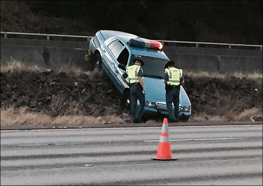Troopers investigate the rammed Seattle PD patrol car Friday morning on Interstate 5. Photo: Courtesy KOMO/4