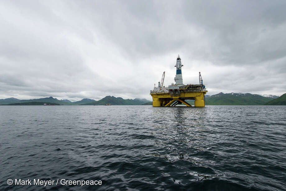 One of Shell's drill rigs, the Polar Pioneer, in a bay in Unalaska's Dutch Harbor, as Shell prepares its equipment to drill for oil in the Chukchi Sea in the Alaskan arctic. (All photos by Mark Meyer/Greenpeace) Photo: Mark Meyer, © Mark Meyer / Greenpeace / ©Mark Meyer/Greenpeace