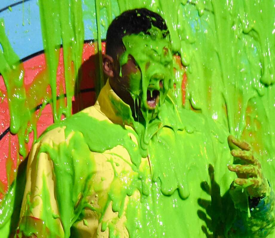 Seattle Seahawks quarterback Russell Wilson gets slimed at the 2015 Nickelodeon Kids' Choice Sports Awards 2015 at UCLA's Pauley Pavilion on July 16, 2015 in Westwood, California. Photo: Kevin Mazur/KCSports2015, Getty Images