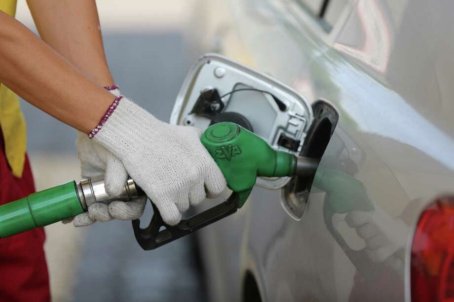 An attendant holds a fuel pump as he refuels an automobile on the forecourt of a gas station operated by Sino Oil & Gas Holdings Ltd. in Almaty, Kazakhstan, on Wednesday, June 24, 2015. The Organization of Petroleum Exporting Countries (OPEC) said its share of the global crude oil market last year declined to the lowest level since 2003, underscoring the motive for the group's current push to defend sales volumes. Photographer: Andrey Rudakov/Bloomberg Photo: Andrey Rudakov / © 2015 Bloomberg Finance LP