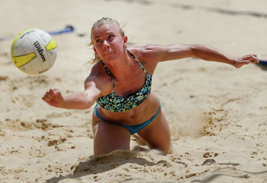 Angela Lowak, a New Braunfels High alumni, lunges for the ball during a game at a Texas Volleyball Tour/ AVPNext sand volleyball tournament at Sideliners Grill on Saturday, July 11, 2015. AVPNext is the official developmental program of the AVP Pro Beach Volleyball Tour. Elite amateur players can earn AVP qualification points, a national ranking and entry into AVP main draws. Lowak will be a senior outside hitter this fall at Texas A&M. (Kin Man Hui/San Antonio Express-News) Photo: Kin Man Hui /San Antonio Express-News / ©2015 San Antonio Express-News