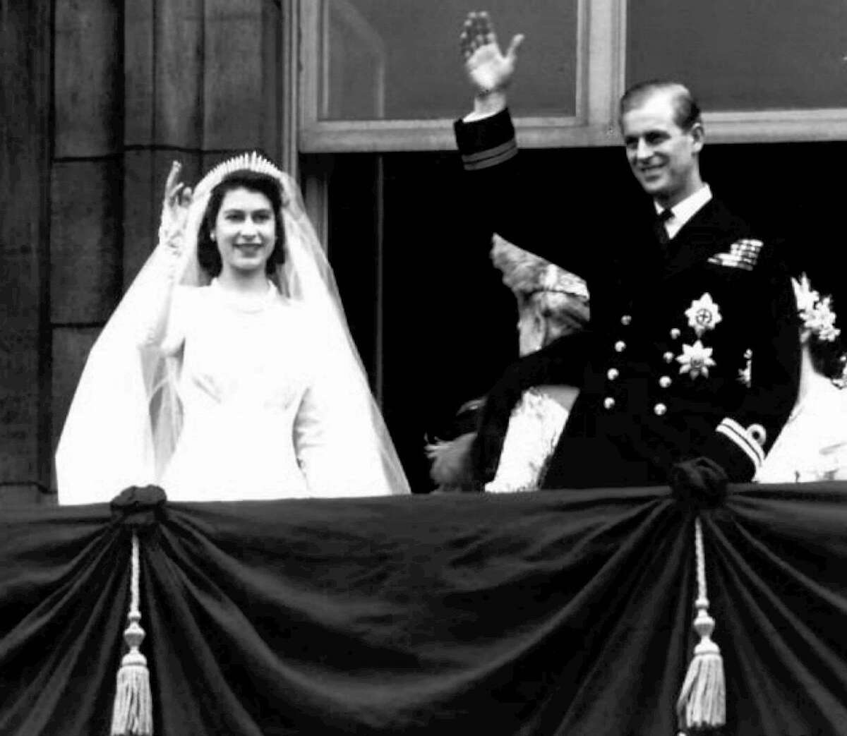 Britain's Queen Elizabeth II and her husband Prince Philip, wave from the balcony of London's Buckingham Palace, following their wedding at Westminster Abbey, in this November 20, 1947 file photo. Keep clicking to take a look at other beautiful royal weddings from around the world.