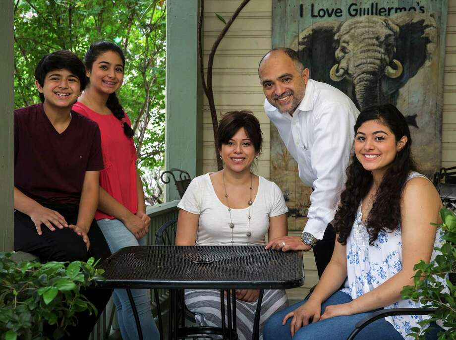 3 Garza children, Aja, Mika and Jerrica, help with the family business. Also pictured is Guillermo with his wife Frances Narvaiz-Garza. Photo: Ray Whitehouse /San Antonio Express-News / 2015 San Antonio Express-News
