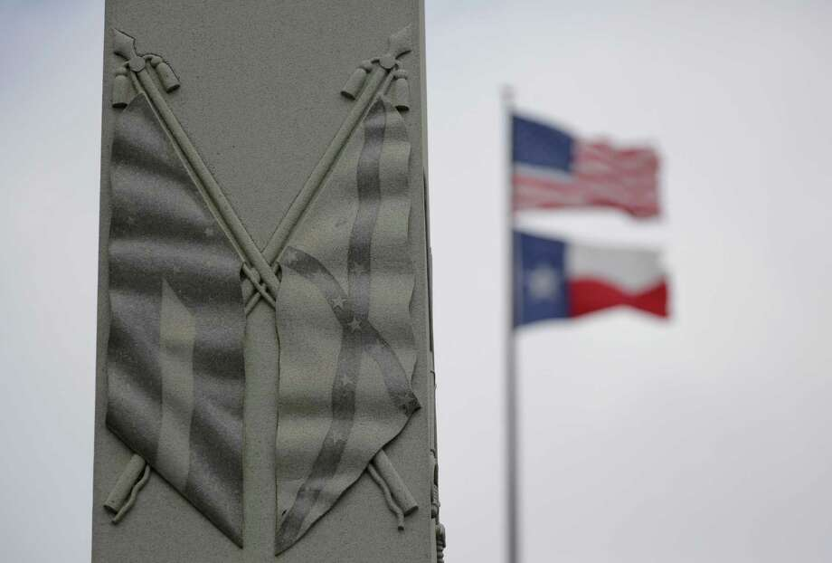 The Confederate flag is seen on a monument to Hood's Texas Brigade at the Texas State Capitol. It has no place on public property. Photo: Eric Gay /Associated Press / AP