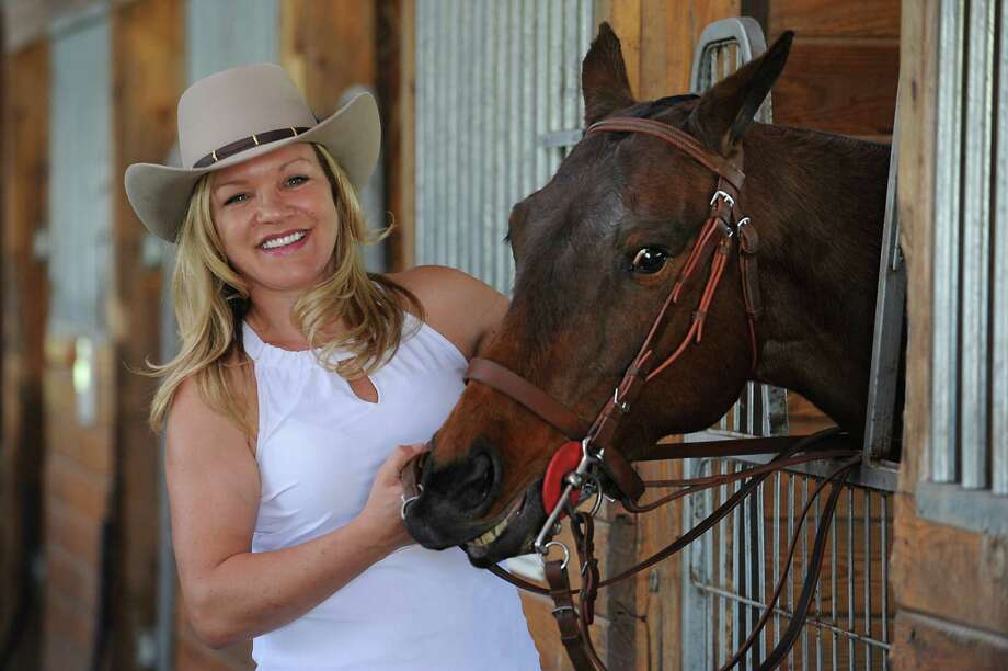 Sabina Rodgers stands with her horse Shakira in a barn on her farm on Thursday, May 7, 2015 in Saratoga Springs, N.Y. (Lori Van Buren / Times Union) Photo: Lori Van Buren / 00031705A