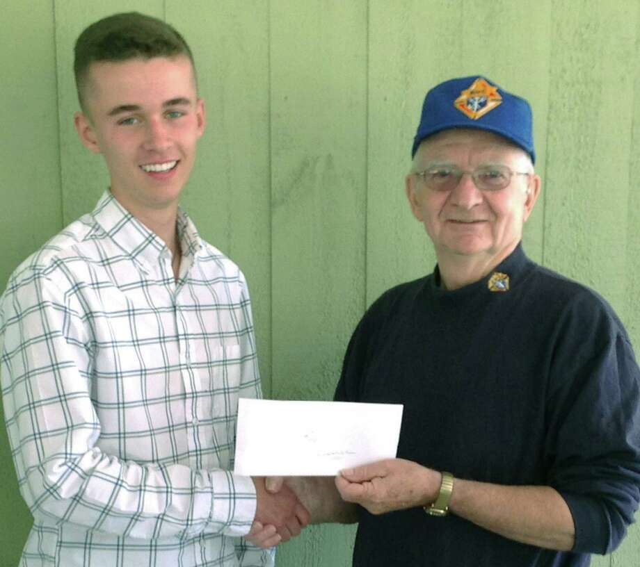 Knights scholarship Our Lady of Perpetual Help Church in Washington and St. Patrick Catholic Church in Roxbury recently hosted their annual parish picnic. During the picnic, the Knights of Columbus Father Thomas Bennett Council 14318 in Washington, represented by Grand Knight Dave DeWitt, right, presented the council's memorial scholarship to Rory Joseph Ronan, son of Rory and Jane Ronan, of Bridgewater. Rory is a graduate of Taft School in Watertown with high honors/cum laude. He will major in finance at Georgetown University's McDonough School of Business in Washington, D.C., this fall. Photo: Contributed Photo / The News-Times Contributed