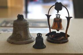 Liberty Bell souvenirs sold during its appearance 100 years ago at the Panama Pacific International Exposition, are displayed in an exhibit at the California Historical Society in San Francisco, Calif. on Friday, July 17, 2015. Historical images of the famous bell's arrival and display at the fair are being archived and exhibited online through a collaboration between the California Historical Society and Historypin.
