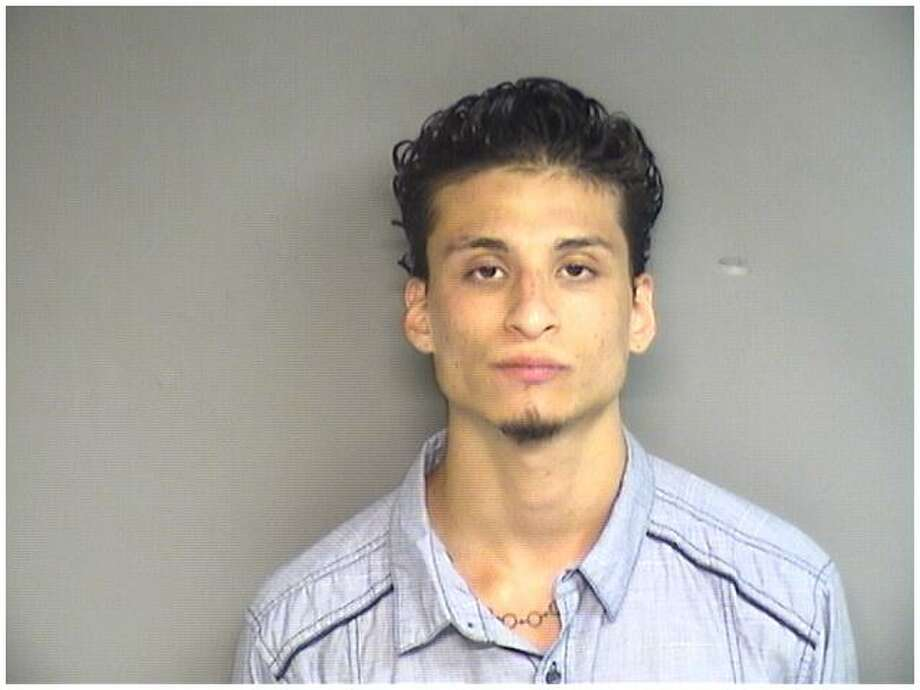 Antonio Lopez-Gonzalez, 21, of Stamford, was charged with breaking into a Fourth Street home and stealing the keys to a Nissan Rogue and driving the vehicle off. Photo: Contributed / Stamford Police / Connecticut Post