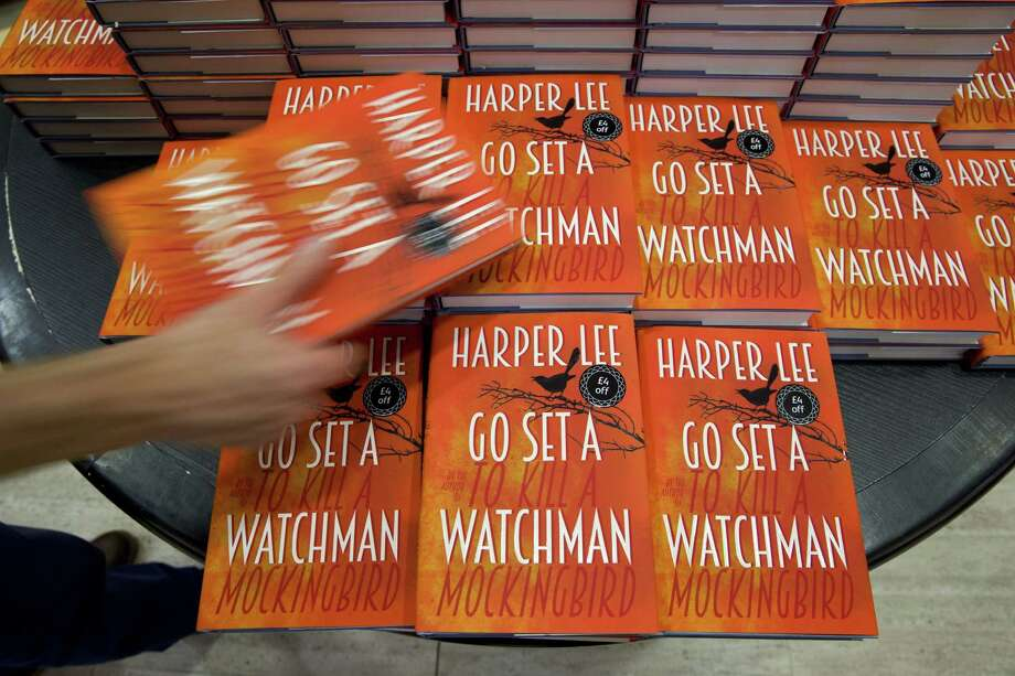 "Copies of Harper Lee's new book ""Go Set a Watchman"" are on display at a bookshop. After reading the novel, two things are clear: Atticus is who he's always been, and Scout is a Daddy's girl who has grown up. And, like Scout, readers too must grow up. Photo: Justin Tallis /AFP / Getty Images / AFP"