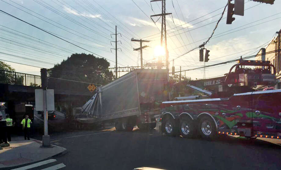 A tractor-truck stuck a railroad bridge Friday morning, July 17, 2015. Route 1 that runs below the railroad bridge, was closed in both directions at Tokeneke Rd. in darien, Conn. for more than an hour. Photo: Contributed / Contributed Photo / Stamford Advocate  contributed