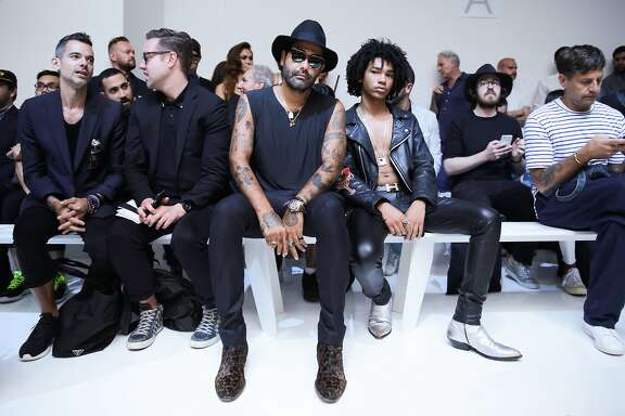Artist Harif Guzman (in hat) and model Luka Sabbat (right) attend Rochambeau's spring 2016 show at Skylight Clarkson Sq on July 14, 2015.