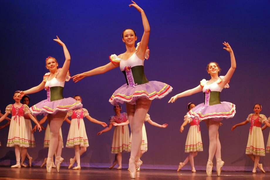 Ashley Cassetta and members of the Darien Art Center dance companies perform at the organization's senior dance concert on June 7 at Darien High School. Photo: Contributed / Contributed / Stamford Advocate Contributed