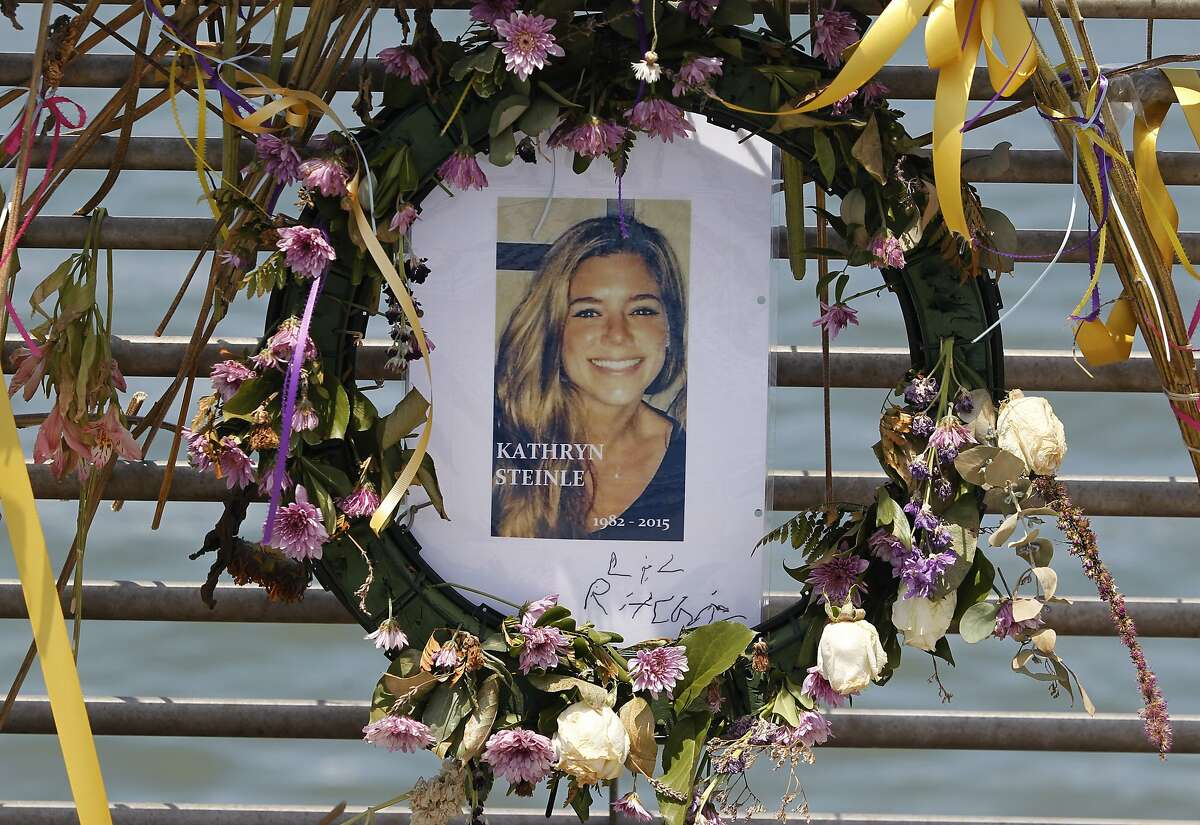 Flowers and a portrait remain at a memorial site for Kathryn Steinle on Pier 14 in San Francisco on July 17, 2015.