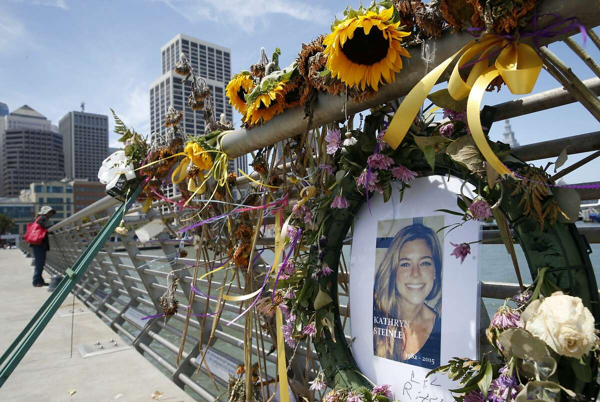 Flowers and a portrait at a memorial site for Kathryn Steinle on Pier 14 in San Francisco on July 17, 2015.