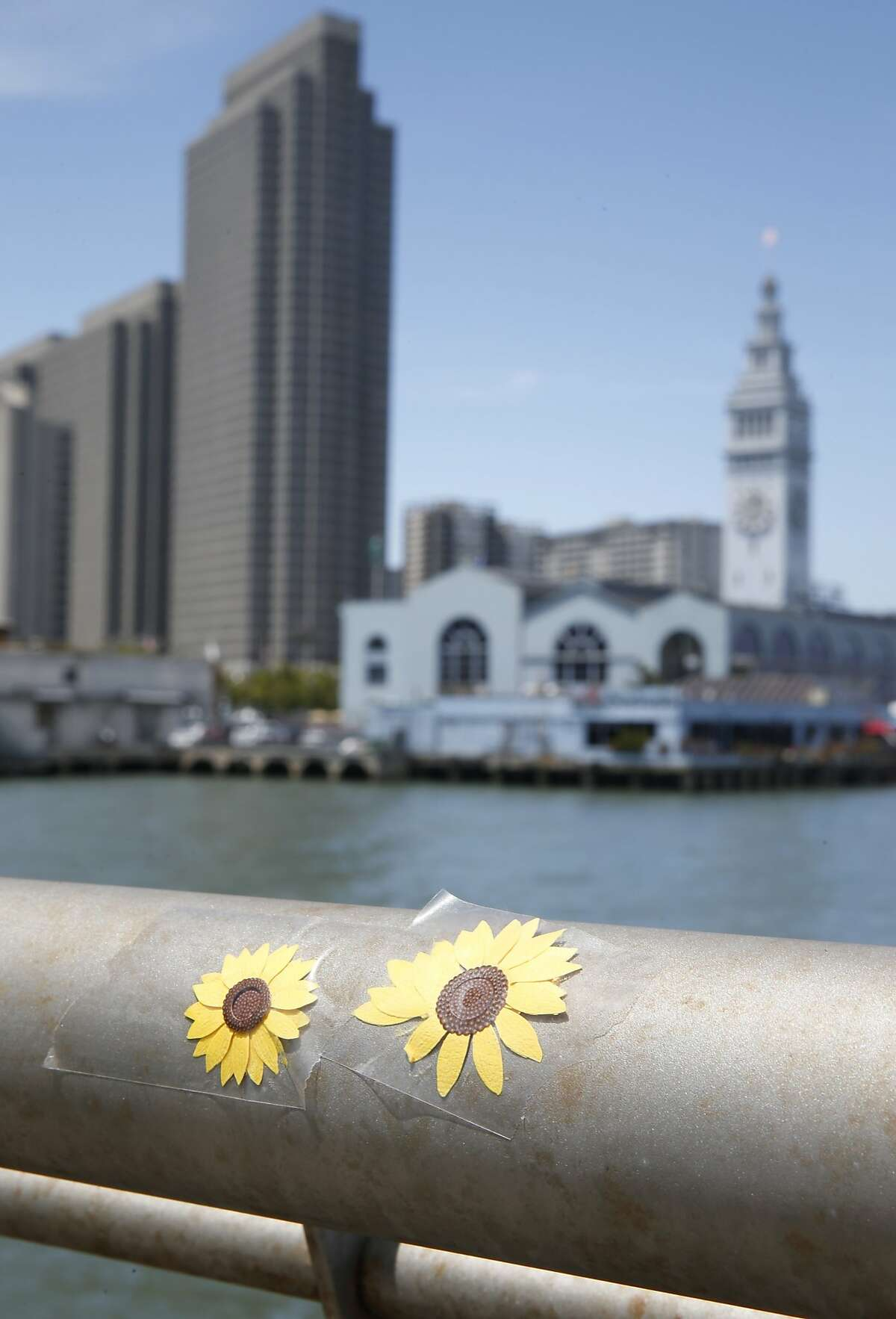 Flowers are taped to the railing at a memorial site for Kathryn Steinle on Pier 14 in San Francisco, Calif. on Friday, July 17, 2015. Steinle was gunned down 2 1/2 weeks ago allegedly by Juan Francisco Lopez-Sanchez, a Mexican citizen who authorities contend is in the country illegally.